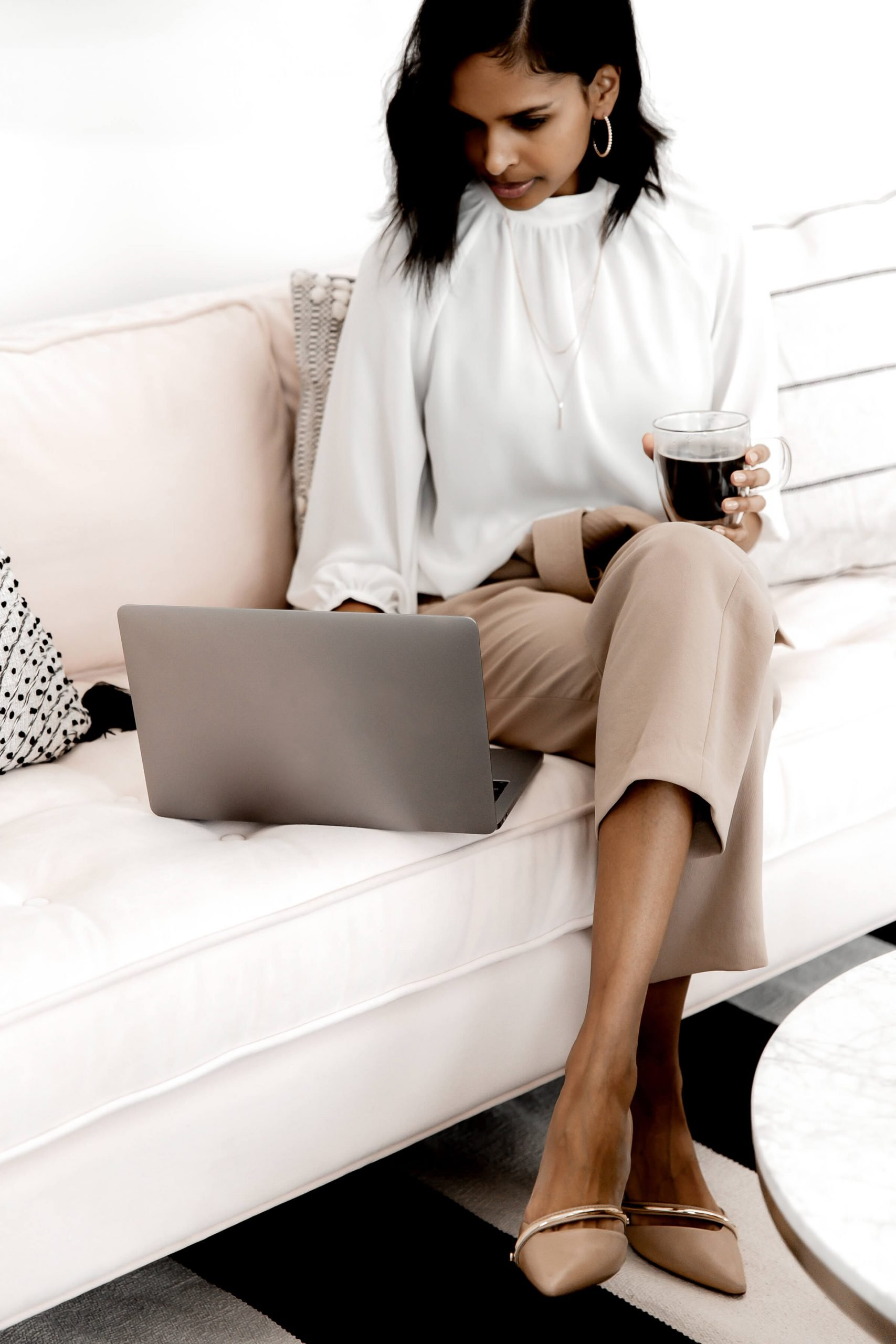 Woman working on computer - CEO Legal Kit & Template for Small Business Owners - The CEO Legal Loft
